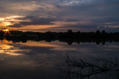Sunrise on a pond stock photography