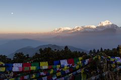 Sunrise from Poon Hill on the Annapurna Circuit. Sunrise and full moon with view of Dhaulagiri mountain from Poon Hill on the Annapurna Circuit royalty free stock images