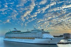 Sunrise Port of Call. A luxury cruise liner sits in port beneath a colorful sunrise sky Stock Photography