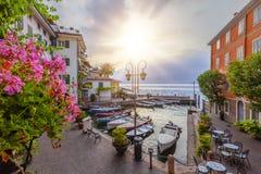 Sunrise at the port of Limone on lake Garda Royalty Free Stock Image