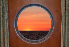 Sunrise Through Porthole Stock Photo