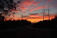 Sunrise and power-lines Stock Image
