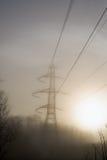 Sunrise power lines haze Royalty Free Stock Image