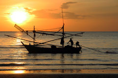 Sunrise at pranburi, thailand. Fisherman back for work in the sea Royalty Free Stock Photos