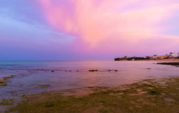 Sunrise at Punta Secca Beach - Montalbano Filming Location. Sunrise at Punta Secca Beach with pink sky in Santa Croce Camerina, Sicily, Italy stock photography