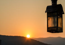 Sunrise in Pushkar, Rajasthan state, India. Detail of old rusty lantern and sunrise Stock Images