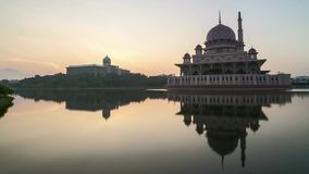 Sunrise At Putrajaya Mosque with reflection. Time lapse 4k Footage of Beautiful Dramatic Sunrise At Putrajaya Mosque with reflection on the water. Pan left stock video