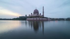 Sunrise at Putrjaya Mosque. Time lapse 4k Footage of Beautiful Dramatic sunrise At Putrajaya Mosque with reflection on the water stock video footage