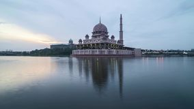 Sunrise at Putrjaya Mosque. Time lapse 4k Footage of Beautiful Dramatic sunrise At Putrajaya Mosque with reflection on the water. Tilt up stock video footage