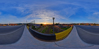 Sunrise at Railway Station, Cluj-Napoca, Romania. 360 panorama a sunrise seen from a bridge above the railway station in Cluj-Napoca, Romania Royalty Free Stock Photos