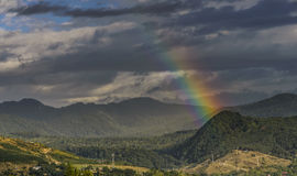 Sunrise with rainbow. Passing through the clouds stock image