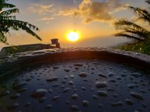 Sunrise after a rainy morning stock images