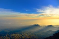 Sunrise rays of light on mountains and dramatic sky. Lombok, Indonesia stock photography
