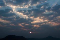 Sunrise rays on morning blue orange sky cloud with mountain. Sunrise rays, on morning blue, orange sky, cloud with mountain Royalty Free Stock Image