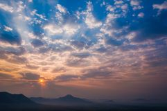 Sunrise rays on morning blue orange sky cloud with mountain landscape soft light. Sunrise rays, on morning blue orange sky, cloud with mountain landscape, soft stock images