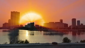 Sunrise rays shine from behind the city. Sunrise rays shine from behind the jeddah city stock video