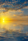Sunrise with rays of the sun  above the sea Royalty Free Stock Photo