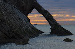 Sunrise with red clouds at bow fiddle rock near Portknockie Stock Photo