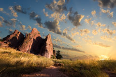 Sunrise on Red Rocks Trail. Dawn over Red Rocks and grass fields in Boulder, CO Stock Images