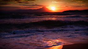 Sunrise reflected. Sun rising over a windy beach Stock Images