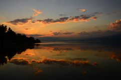 Sunrise. With reflection on the lake Royalty Free Stock Image