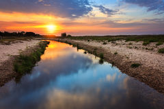 Sunrise with reflection in river landscape Royalty Free Stock Photography