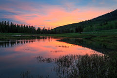 Sunrise reflection in the Uinta Mountains. Stock Images