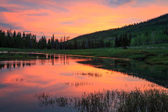Sunrise reflection in the Uinta Mountains. Royalty Free Stock Images