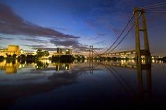 Sunrise with reflections. Sunrise of Putra Jaya, Malaysia where the unfinished monorail bridge as foreground Stock Photography
