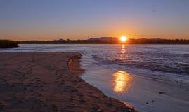Sunrise reflections over tidal outflow of the Santa Clara river estuary at McGrath State Park of Ventura California USA stock photos