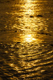 Sunrise reflective surface on river Stock Photography