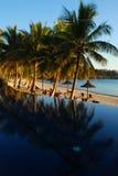 Sunrise on resort swimming pool Stock Photography