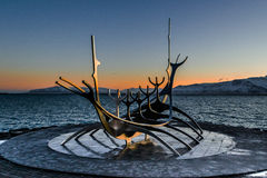 Sunrise in Reykjavik. Centre in Reykjavik city, a popular monument of viking´s ship Stock Photo