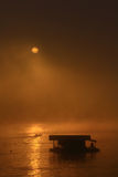 Sunrise on the river. Sunrise on the river on fog day royalty free stock photography