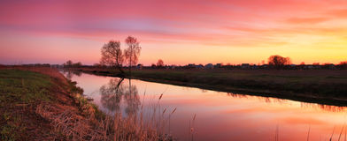Sunrise on the river bank. Panorama of Sunrise on the river bank Royalty Free Stock Images
