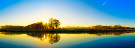 Sunrise at the river. Beautiful sunrise at the river with reflexion on the water royalty free stock photography