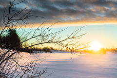 Sunrise At The River 1. The beautiful winter sunrise casted long shadows on the ice on the river royalty free stock image