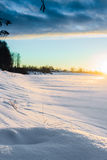Sunrise At The River 3. The beautiful winter sunrise casted long shadows on the ice on the river stock images