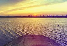 Sunrise at a river Stock Photos
