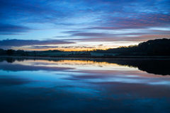 Sunrise on the river lynher with beautiful sky and reflections at st germans, cornwall, uk Royalty Free Stock Images