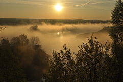 Sunrise. The river in the mist. A view of the meadows and the river Royalty Free Stock Image