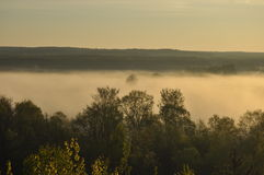 Sunrise. The river in the mist. A view of the meadows and the river Royalty Free Stock Images
