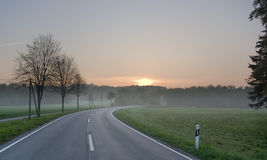 Sunrise road. Country road during sunrise in early spring in Germany Europe royalty free stock photography