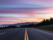 Sunrise on the road to white mountains. Amazingly beautiful sunrise in white mountains, colorful and foggy Royalty Free Stock Photos