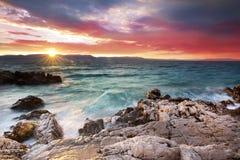 Sunrise on the rock beach, Istria, Croatia Royalty Free Stock Photo