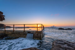 Sunrise on the Rockpool. Sunrise on the rock pool at North Curl Curl Beach,North Curl Curl, New South Wales, Australia Royalty Free Stock Photo