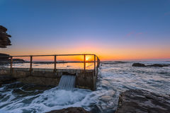 Sunrise on the Rockpool. Sunrise on the rock pool at North Curl Curl Beach,North Curl Curl, New South Wales, Australia Royalty Free Stock Image