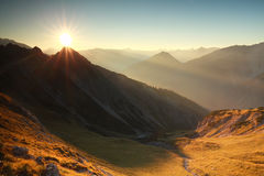 Sunrise in rocky Alps Stock Images