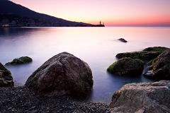 Sunrise on the rocky coast of Black sea Stock Photography