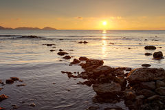 Sunrise on the rocky coast of Black sea Stock Image